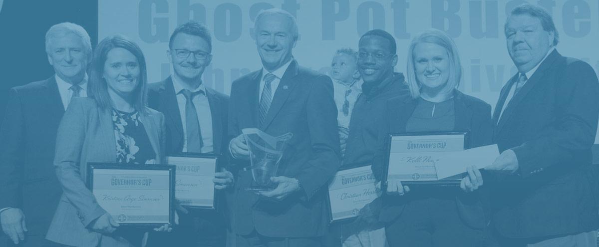 people holding awards